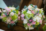 Hydrangea, roses, callas, seeded eucalyptus and some pearls
