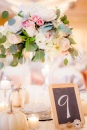 centerpiece 2- tall floral arrangement of roses, seeded euc, and hydrangea