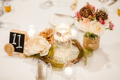 centerpiece 1- mason jars, flowers, floating candles, a ring of burlap flowers and twigs